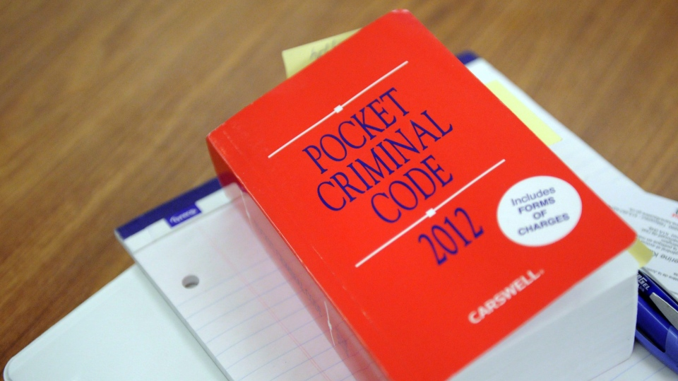 A book called 'The Pocket Criminal Code' is pictured in Ottawa in this file photo from February 2012. (Sean Kilpatrick / THE CANADIAN PRESS)