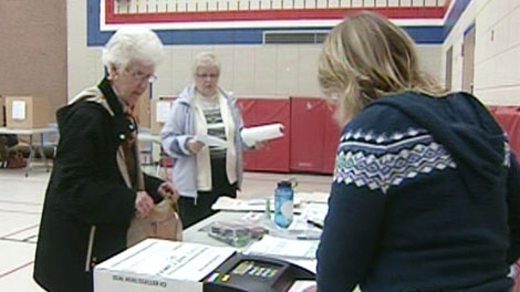 Voters cast their ballots at a polling station in Waterloo Region, Monday, Oct. 25, 2010.