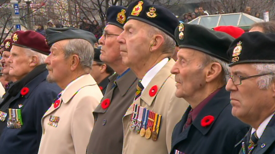 Men in uniform attend a Remembrance Day ceremony being held at Parliament Hill in Ottawa on Sunday, Nov. 11, 2012.