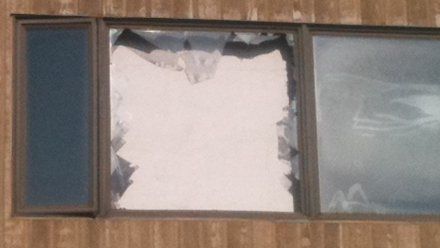 A broken window is seen after a fire in Cambridge, Ont. on Friday, Nov. 16, 2012. (Phil Molto / CTV Kitchener)