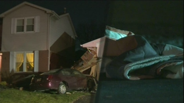 Car slams into garage in Waterloo