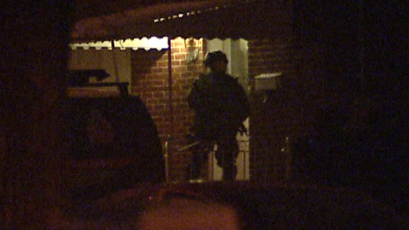Police surround a home on Talbot street in Kitchener. Dec 3, 2012