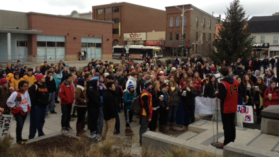 Approximately 175 students hold a rally in Uptown Waterloo Square, protesting recent cancellation of extra curricular activities. Dec. 10, 2012