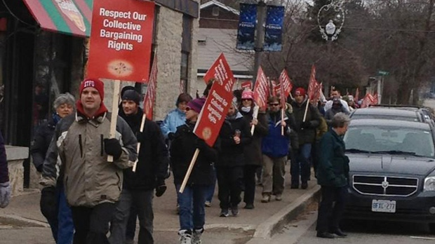 Upper Grand District School Board teachers protest in Fergus, Ont., as part of a one-day strike on Friday, Dec. 14, 2012. (Abigail Bimman / CTV Kitchener)