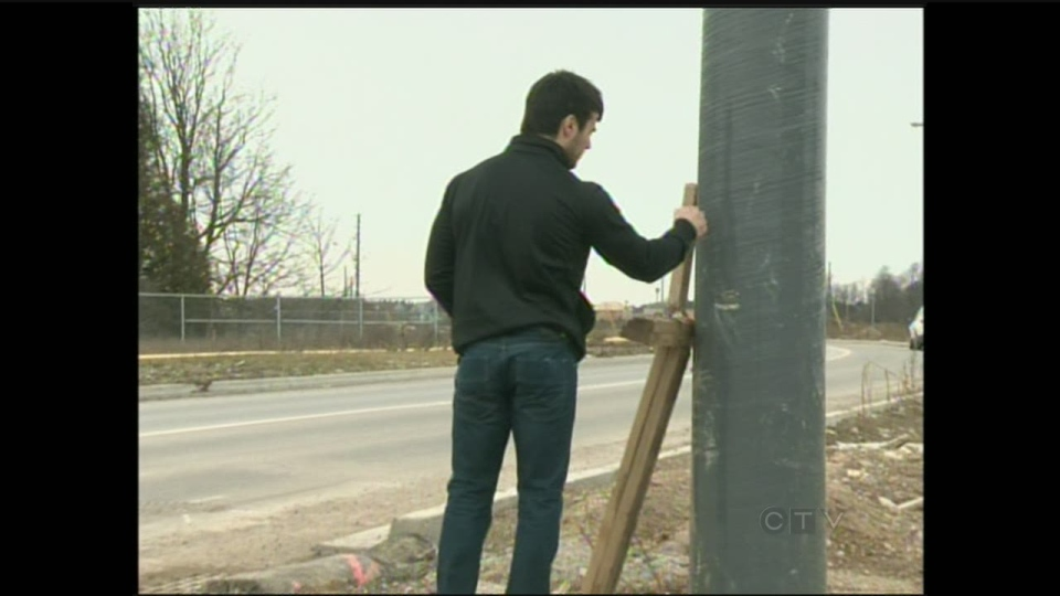 Ryan Burnham visits the spot in Guelph, Ont., where his cousin Eric Goegans lost control of his car and drove into a pole. (CTV Kitchener)