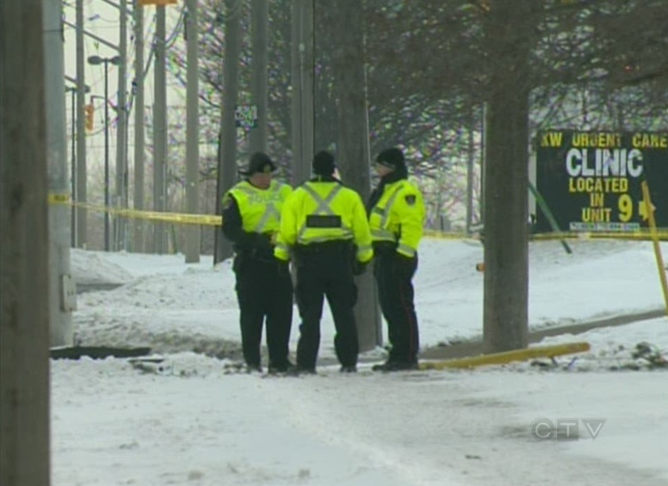 Waterloo Regional Police officers are seen investigating a crash at Fairway Road and Wilson Avenue in Kitchener, Ont., on Friday, Jan. 4, 2013. (CTV Kitchener)