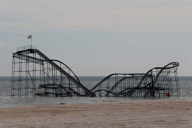 Man climbs Sandy-stricken roller coaster