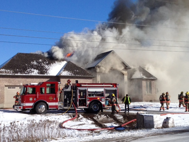 Heavy smoke is seen at the scene of a house fire on Northumberland Street in Ayr, Ont., on Thursday, Jan. 24, 2013. (Kevin Doerr / CTV Kitchener)
