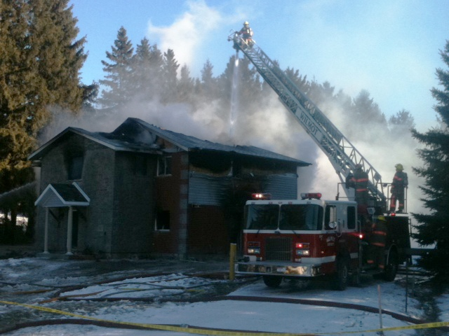 Firefighters battle a house fire on Snyders Road in Petersburg, Ont., on Thursday, Jan. 24, 2013. (Phil Molto / CTV Kitchener)