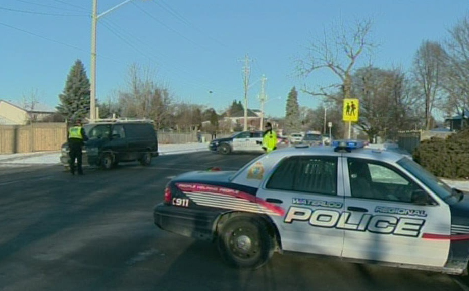 A Waterloo Regional Police cruiser blocks off the intersection of Blair Road and Bismark Drive in Cambridge, Ont., after a crossing guard was hit by a van on Thursday, Jan. 24, 2013. (CTV Kitchener)