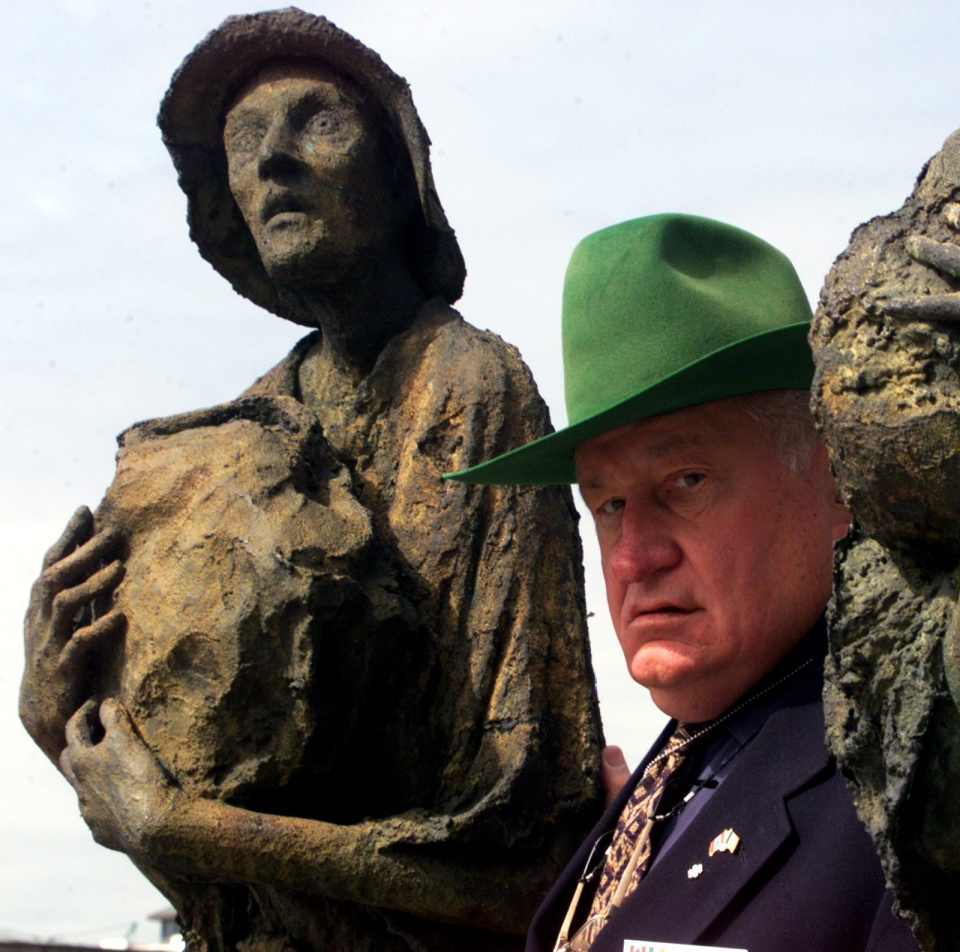 Eugene Whelan walks past one of the statues at the Famine Memorial during a tour in Dublin, Ireland Tuesday June 15, 1999. (CP PHOTO/Tom Hanson)