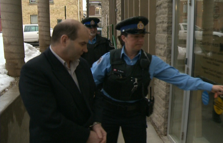 Terry Tremble is led into a court in Guelph, Ont., in this file photo. (CTV Kitchener)