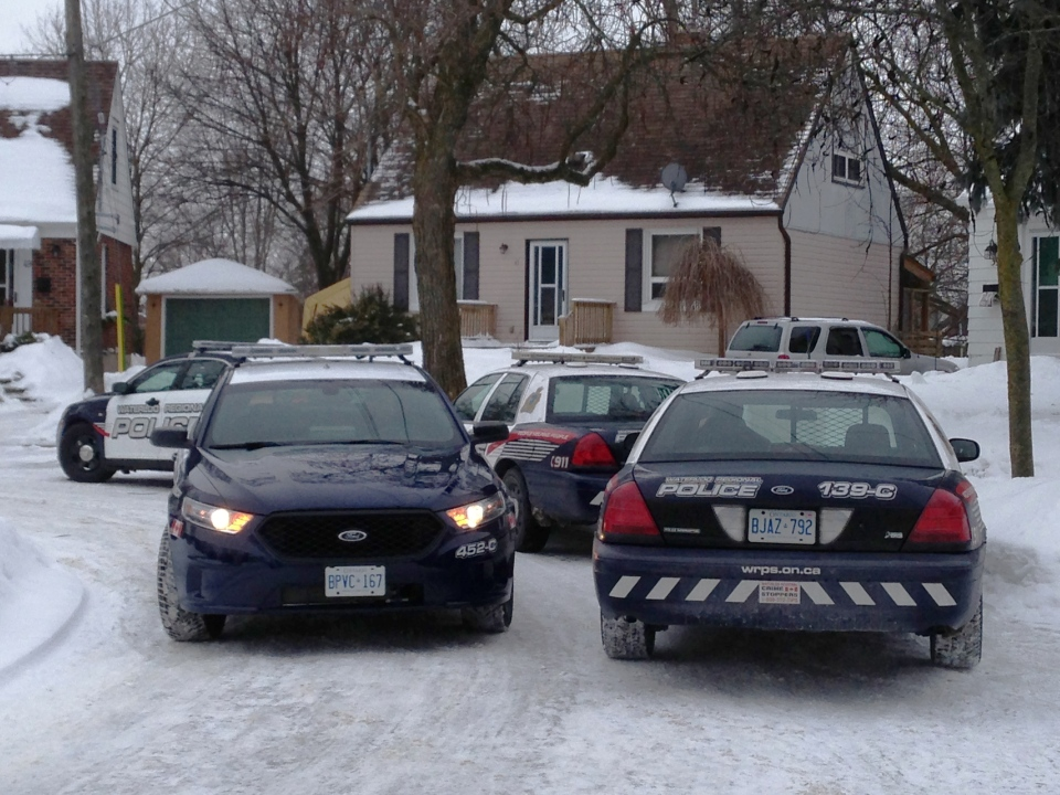 Police cars are seen at the scene of a home invasion on Norfolk Crescent in Kitchener, Ont., on Friday, Feb. 22, 2013. (Brian Dunseith / CTV Kitchener)