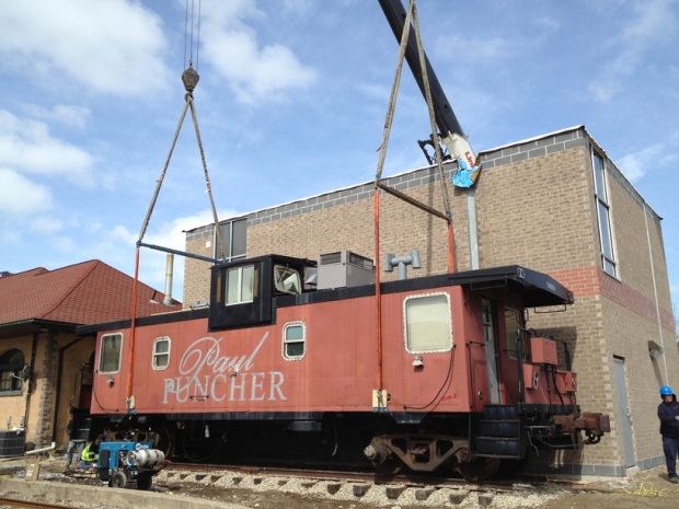 Cranes prepare to move a caboose containing a tailor shop in Waterloo, Ont., on Monday, March 25, 2013. (David Imrie / CTV Kitchener)