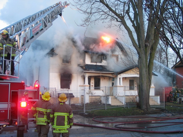 Firefighters battled a fire at a vacant home on Weber Street in Kitchener, Ont., on Monday, April 15, 2013. (Courtesy Brent W.J. Mackie)
