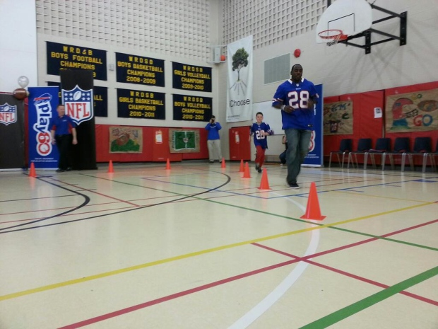 Buffalo Bills running back C.J. Spiller races nine-year-old Ronan Freeman at W.T. Townshend Public School in Kitchener, Ont. on Monday, April 22, 2013. (Max Wark / CTV Kitchener)