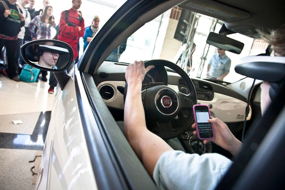 Freshman student Ben Fisher texts and virtually drives in the Texting and Driving Simulator at Central York High School in Pennsylvania on March 8, 2013. (York Daily Record / Sonya Paclob)
