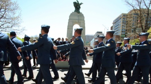 Members of the Canadian military march past the National War Memorial during a ceremony in commemoration of the Battle of the Atlantic, in Ottawa Sunday May 5, 2013. (THE CANADIAN PRESS / Fred Chartrand)
