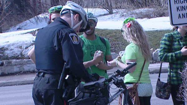 Police issue tickets to St. Patrick's day revellers in Waterloo, Ont. on Thursday, March 17, 2011.