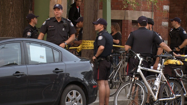 Police investigate shooting near Ossington Avenue and Dundas Street West in Toronto, Ont. on Sunday, May 19, 2013.