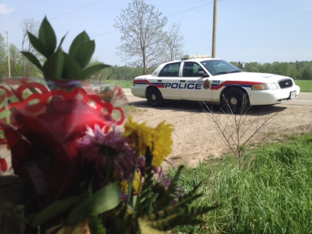 A Hamilton Police Service cruiser sits at the North Dumfries, Ont., farm owned by Dellen Millard on Tuesday, May 21, 2013. (Kevin Doerr / CTV Kitchener)