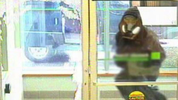 Second suspect in TD Canada Trust bank robbery seen in security footage. -- July 4, 2013