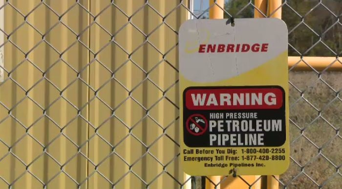 A sign for the Enbridge Line 9 oil pipeline is seen in North Dumfries, Ont., on Wednesday, Sept. 25, 2013.