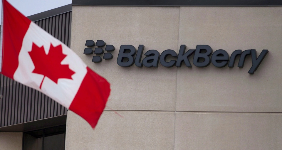 A Canadian flag flies at BlackBerry's headquarters in Waterloo, Ont., Tuesday, July 9, 2013. (Geoff Robins / THE CANADIAN PRESS)