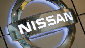 Nissan Motor Co. emblem on the wall of a showroom in Tokyo, on June 25, 2013. (Itsuo Inouye / AP)