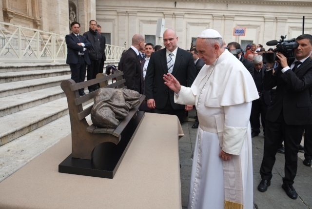 Pope Francis examines the 'Jesus the Homeless' sculpture in Vatican City as creator Tim Schmalz looks on in the Vatican.
