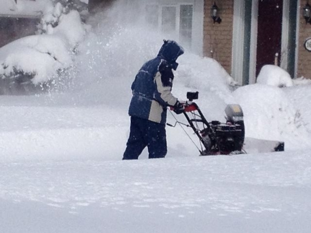 Residents dig out after snow blanketed Wingham, Ont. on Monday, Jan. 6, 2013. (Scott Miller / CTV London)