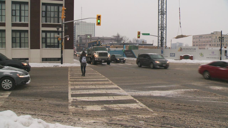 A pedestrian crosses Victoria Street at King Street in Kitchener on Friday, Jan. 10, 2014.