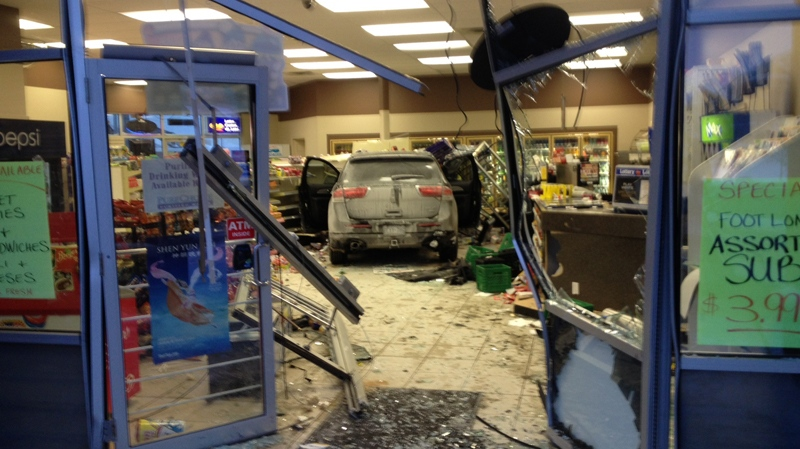An SUV crashed into a convenience store near the intersection of Laurelwood Drive and Erbsville Road in Waterloo on Tuesday, Jan. 28, 2014. (Kevin Doerr / CTV Kitchener)