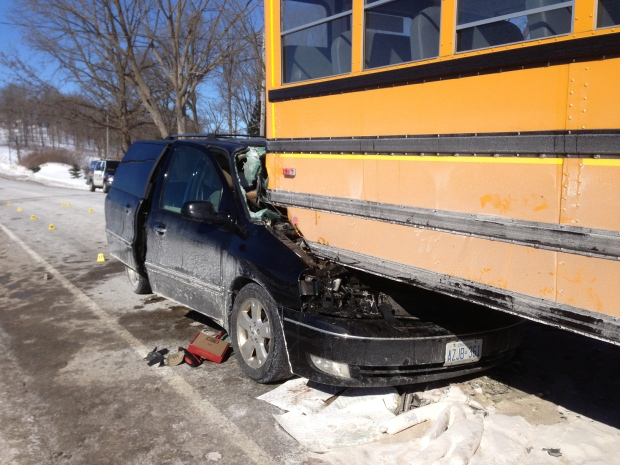 A 64-year-old woman was seriously injured when her minivan collided with a school bus near Hawkesville, Ont., on Thursday, March 6, 2014. (Brian Dunseith / CTV Kitchener)