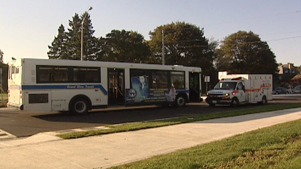 A Grand River Transit bus and an ambulance sit at the scene of a pedestrian collision at a roundabout in Kitchener, Ont. on Friday, Oct. 7, 2011.