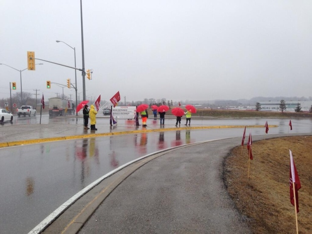 Pro-unionization marchers stand outside the Toyota plant in Woodstock, Ont. on Friday, April 4, 2014. (Cara Campbell / CTV London)