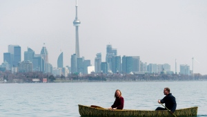 People take in the warm weather as they canoe on Lake Ontario near Humber Bay Park in Toronto on Monday, April 21, 2014. (Nathan Denette/The Canadian Press)