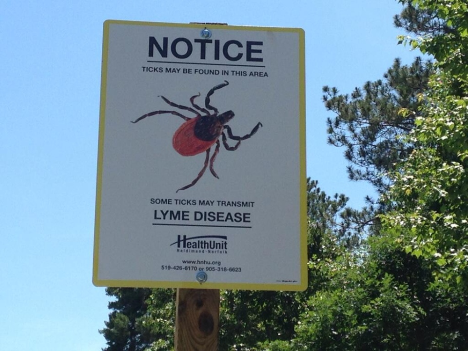 A sign warning parkgoers about the presence of deer ticks in Turkey Point Provincial Park is seen on Friday, June 27, 2014. (Abigail Bimman / CTV Kitchener)