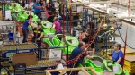Employees work on the SeaDoo assembly line at the Bombardier Recreational Products plant Thursday, June 12, 2014 in Valcourt, Quebec. (Ryan Remiorz)