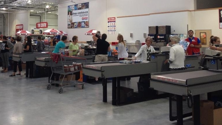 Shoppers go through the checkouts at the Costco store in Guelph, Ont., on Friday, July 25, 2014. (Krista Simpson / CTV Kitchener)