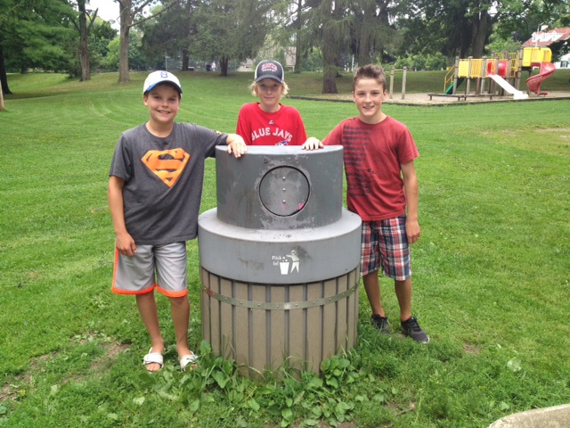 Alex Fullerton, Gillis Haskell and Aidan Haskell found a small dog in this garbage can at Victoria Park in Cambridge. (Rosie Del Campo / CTV Kitchener)