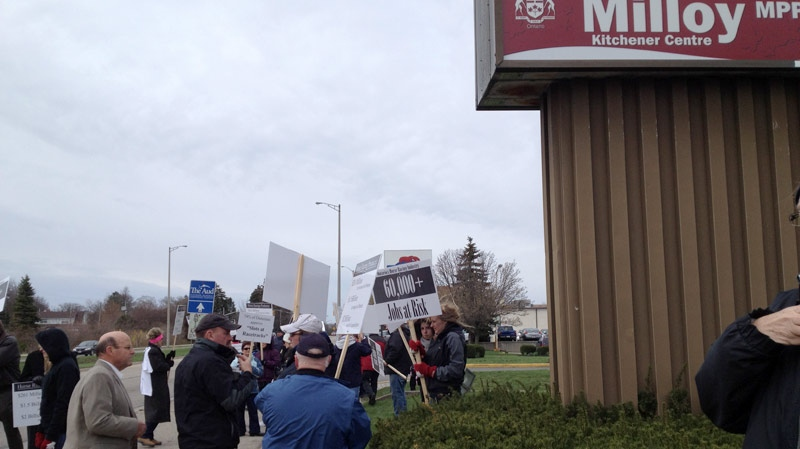 Protesters in support of the horse industry gather outside the offices of Kitchener Centre MPP John Milloy in Kitchener, Ont. on Friday, March 30, 2012. (Lee Boyadjian / CTV News)