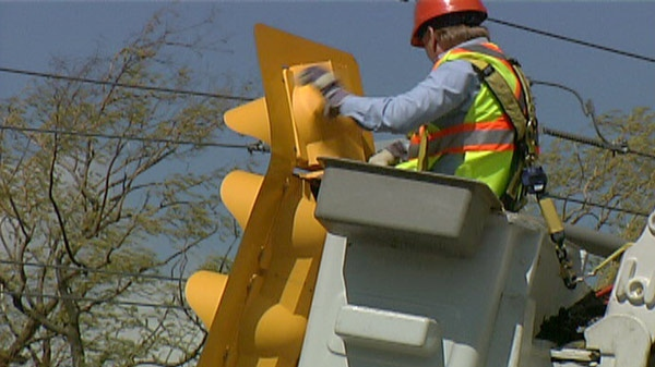Crews work to repair traffic lights after high winds in Waterloo Region, Ont. on Monday, April 16, 2012.
