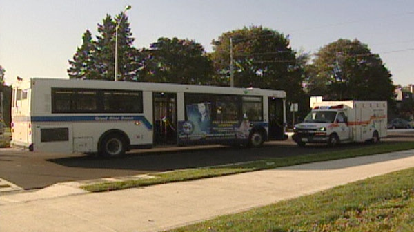 A Grand River Transit bus sits at the scene of a pedestrian collision at a roundabout in Kitchener, Ont. on Friday, Oct. 7, 2011.