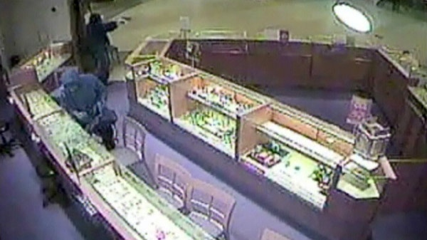 Surveillance video images released by Guelph police show two suspects during a robbery at the Peoples Jewellers in Stone Road Mall in Guelph, Ont.