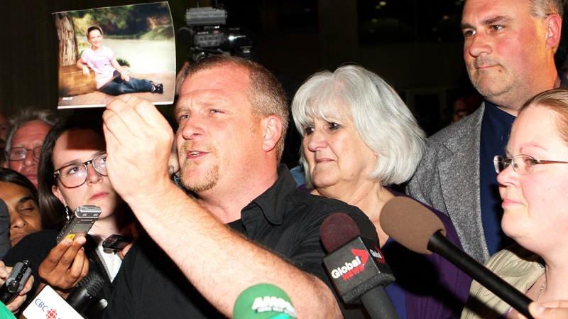 Rodney Stafford, father of slain Victoria Stafford holds a photo of his daughter as he speaks to the media, with his mother Doreen Graichen, sister Rebecca Nichols and brother Rob Stafford looking on, after Michael Rafferty was found guilty on all three charges at the murder trial in London, Ont., Friday, May 11, 2012. (Dave Chidley / THE CANADIAN PRESS)