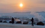 People walk along a path in Iqaluit, Nunavut on Tuesday, Dec. 9, 2014. (Sean Kilpatrick / THE CANADIAN PRESS)
