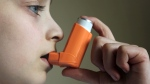 A child uses a puffer in this file photo. (sarra22/Shutterstock.com)