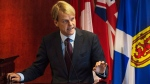 Minister of Citizenship and Immigration Chris Alexander speaks to the media about Canada's plan to provide faster help for Syrian and Iraqi Refugees wishing to come to Canada during a press conference in Toronto on Saturday, September 19, 2015. (Aaron Vincent Elkaim / THE CANADIAN PRESS)