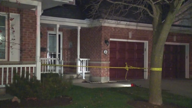 Police tape blocks off Alastair Wood's home at Village by the Arboretum in Guelph on Tuesday, Nov. 24, 2015.
